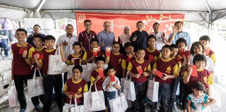 An alms-giving event by SWM Environment Sdn Bhd